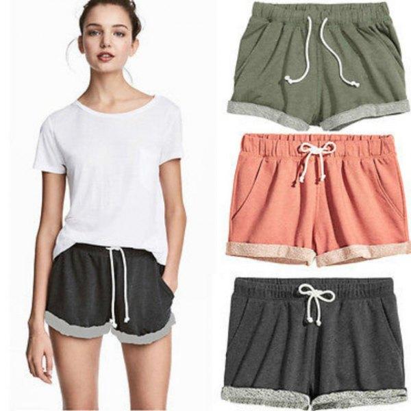 white t shirt with black mini sweatpant shorts