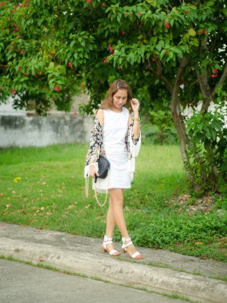 white tank top with mini pleated skirt and sandals