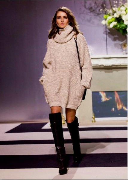 white turtleneck chunky sweater dress with black thigh high leather boots