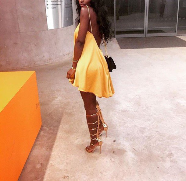 yellow backless skater dress with matching lace up heels