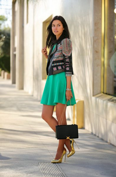 black and gold leather jacket with grey mini pleated dress