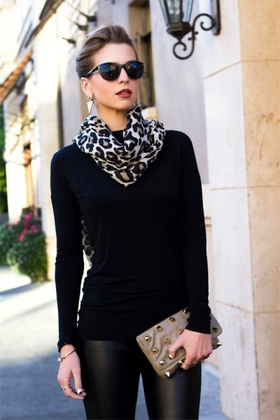 black and white leopard printed scarf with sweater and leather pants