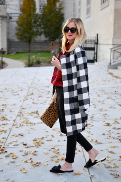 black and white plaid longline wool coat with leopard print clutch bag