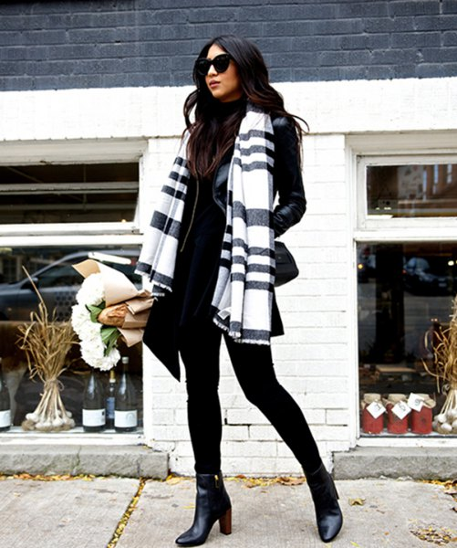 black and white scarf with mock neck sweater and leather jacket