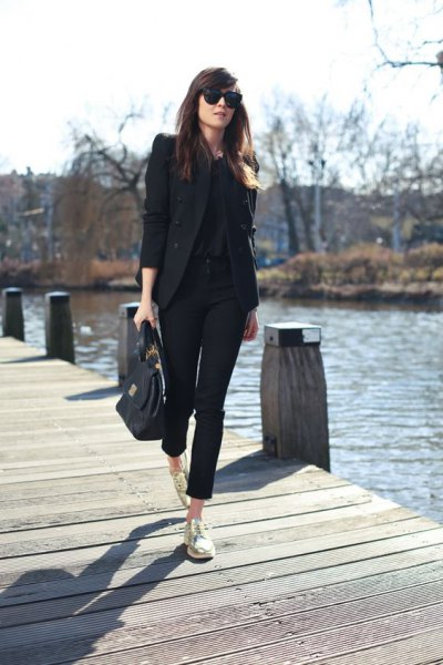 black blazer with cropped chinos and gold low top sneakers