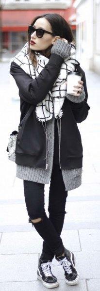 black bomber jacket with grey knit cardigan