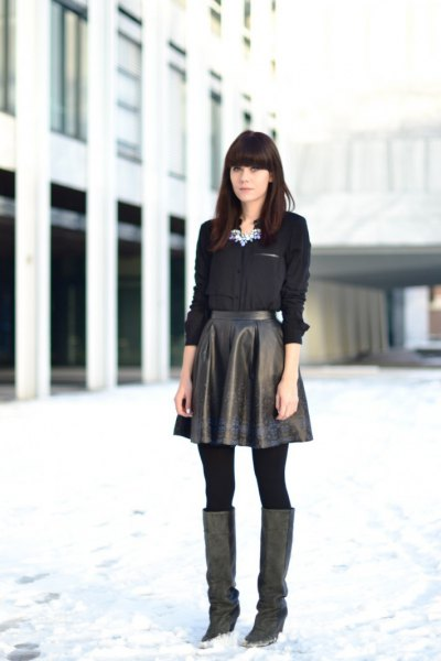 black button up shirt with leather high rise flared skirt
