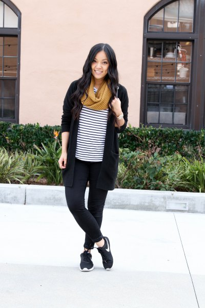 black cardigan with striped tee and walking sneakers