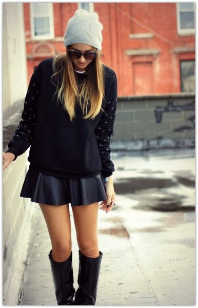 black chunky sweater with mini skater skirt and knee high boots