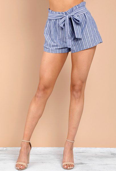 black cropped t shirt with blue and white striped mini tie shorts