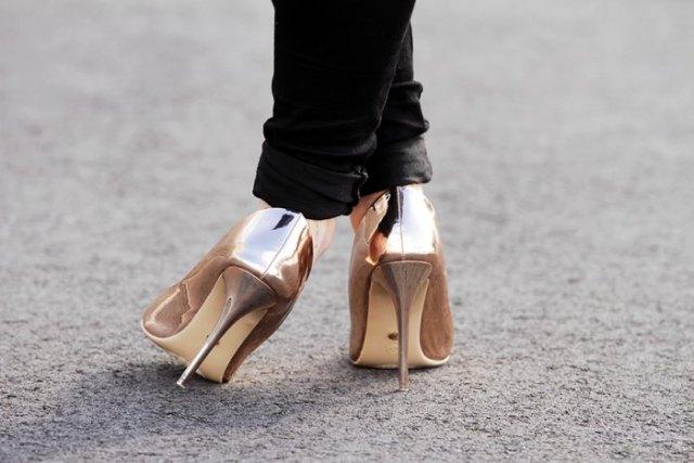 black cuffed slim fit jeans and metallic gold heels