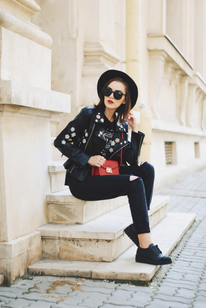 black leather hat with embroidered biker jacket and skinny jeans