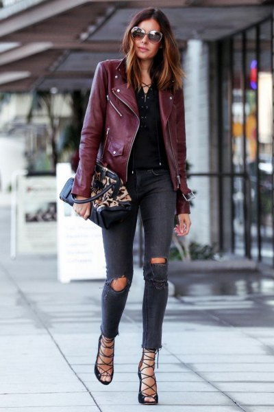 black leather jacket with dark blue ripped knee skinny jeans