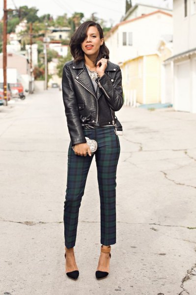 black leather jacket with navy and grey plaid skinny pants