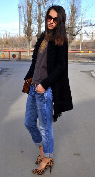black long cardigan with blue jeans and animal print shoes