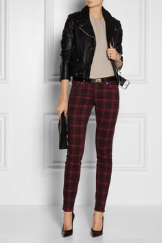black moto jacket with grey blouse and plaid pants