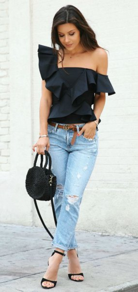 black ruffle shoulder strapless blouse with light blue slim fit jeans