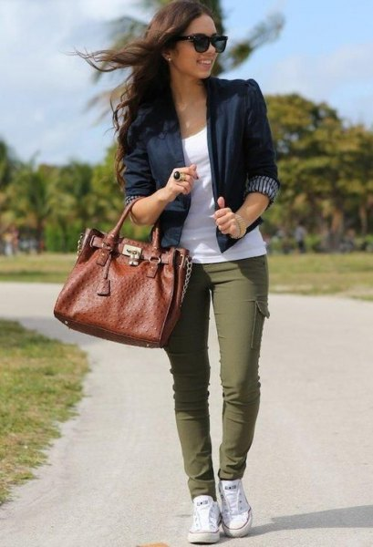 black slim fit blazer with white tee and green pants