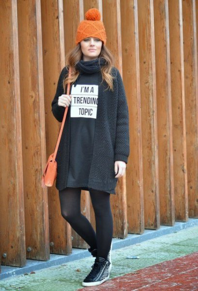 black sweatshirt dress with stockings and walking shoes