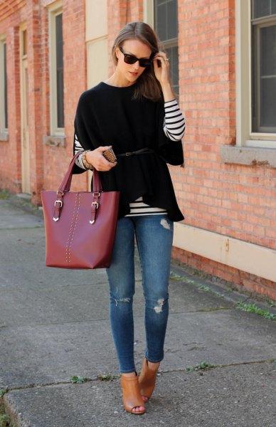 black wide sleeve sweater over striped long sleeve tee