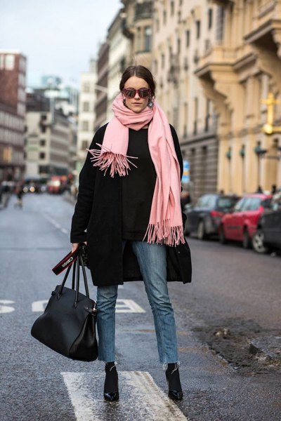 black wool coat with pale pink fringe scarf and black cropped slim fit jeans