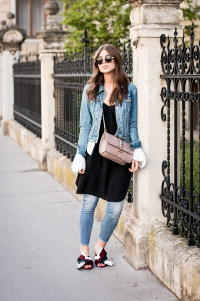 blue denim jacket with black tunic dress and gold slippers