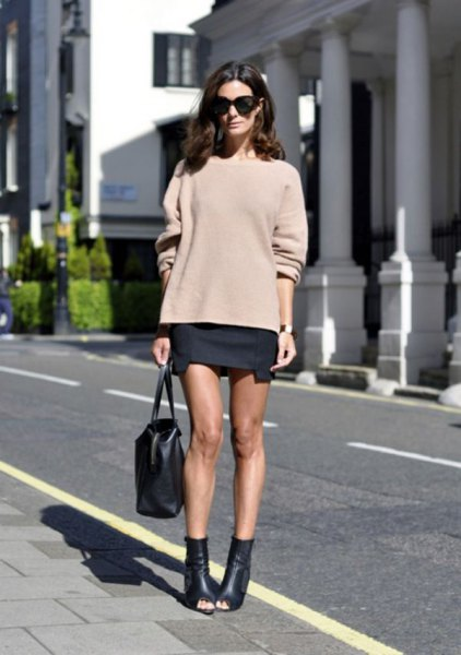 blush pink chunky sweater with black mini skirt and open toe leather ankle boots