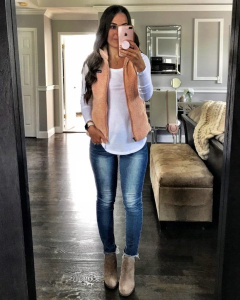 blush pink vest with white long sleeve tee and skinny fleece lined jeans