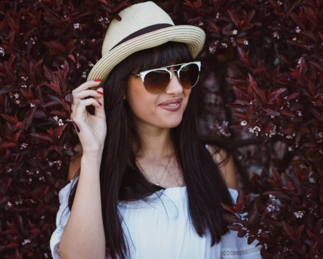 bush hat with white off the shoulder blouse