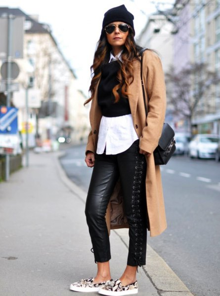 camel longline wool coat with black leather leggings and animal print canvas shoes