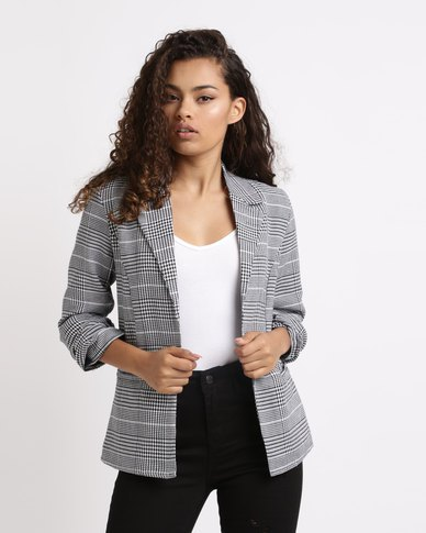 checkered blazer with white tank top and high rise black jeans