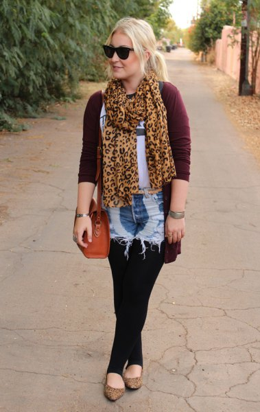 gold and black leopard print chiffon scarf with black cardigan and washed denim shorts