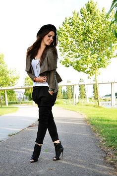 green blazer with white tank top with black heeled peep toe ankle boots