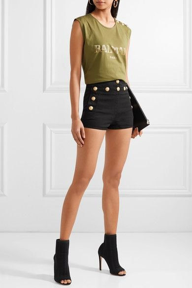 green sleeveless top with black button front denim designer shorts