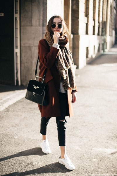 green sweater with oversized scarf and black leather cropped pants