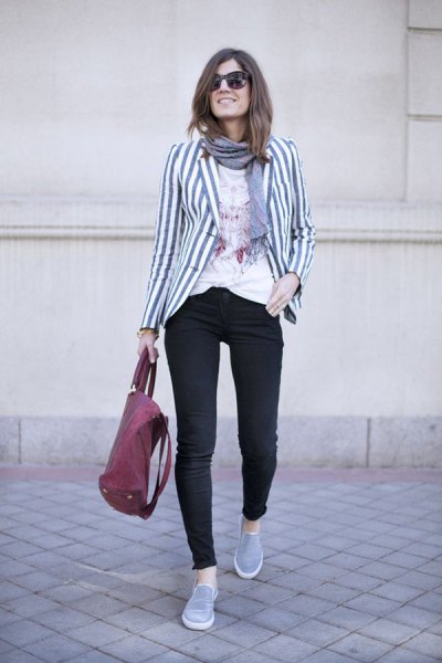 grey and white striped blazer with black skinny jeans and tennis shoes