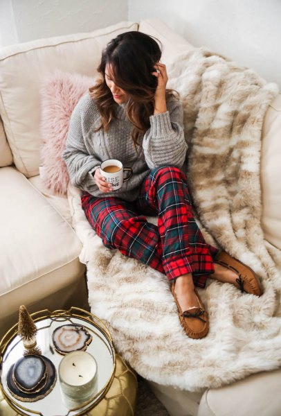 grey cable knit sweater with red and blue plaid pajama pants
