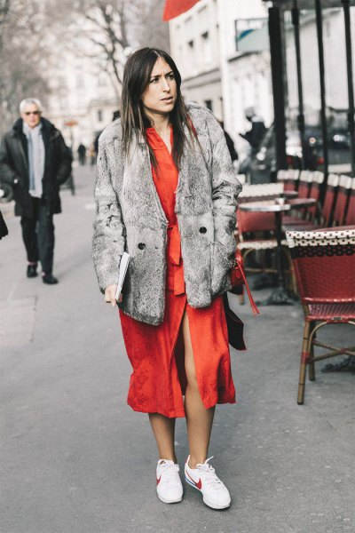 grey faux fur coat with orange midi dress and white walking tennis shoes