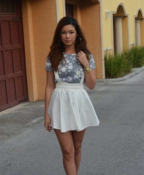 grey floral printed tee with white mini skater suspender skirt