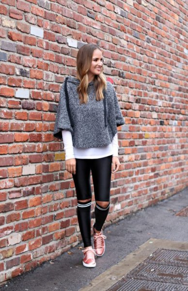 grey heather grey sweater with black leather knee length skinny pants