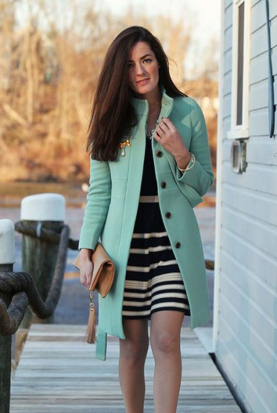 grey long coat with black and white striped mini dress