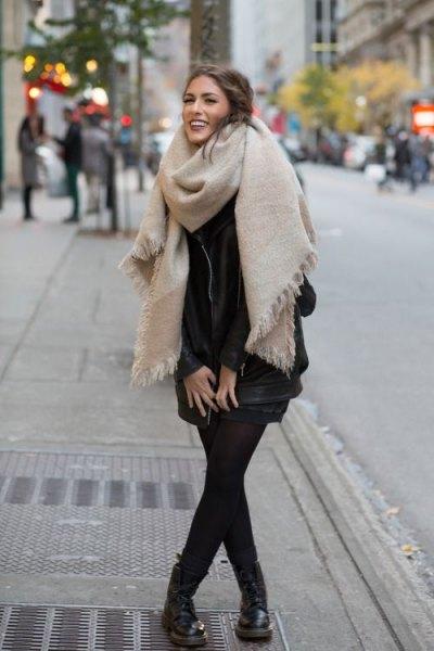 ivory oversized fringe scarf with black mini shirt dress and leather boots