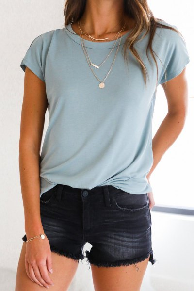 light teal blue t shirt with black washed mini shorts