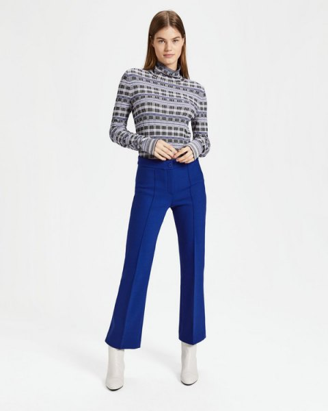 mock neck black printed sweater with blue flared pants