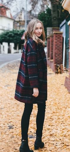 navy and red plaid coat with black skinny jeans and boots