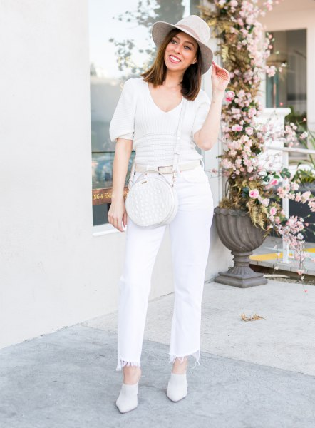 pale pink floppy hat with off white cut off straight cut jeans