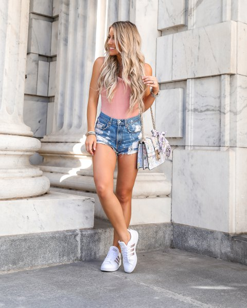 pale pink ribbed form fitting sleeveless top with blue denim shorts and walking sneakers