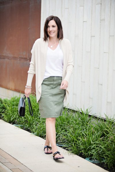 pale pink sweater cardigan with white v neck tee and knee length skirt