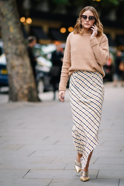 pink ribbed chunky sweater with black and white plaid maxi skirt