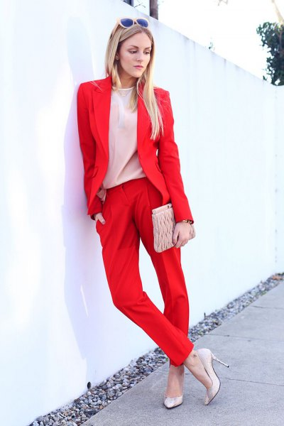 red blazer with pale pink chiffon blouse and clutch bag